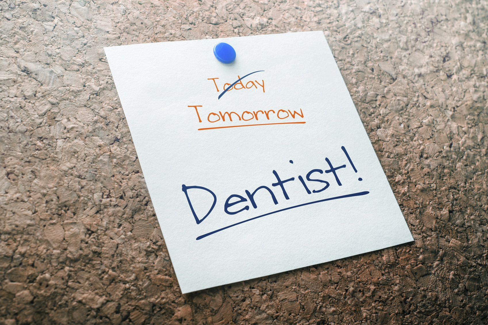 Dentist Reminder For Tomorrow With Crossed Out Today Pinned On Cork Board