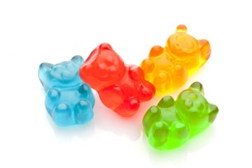 Horizontal shot of four gummy bears candies isolated on white background. DSRL high key studio photo taken with Canon EOS 5D Mk II and Canon EF 100mm f/2.8L Macro IS USM